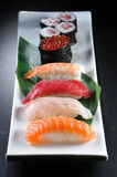 Sushi. Japanese sushi on a white plate royalty free stock photography