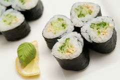 Sushi. Traditional the Japanese meal sushi on a white background Royalty Free Stock Images
