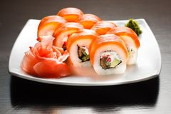 Sushi. On wight plate isolated on black table Royalty Free Stock Image