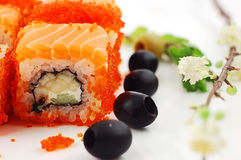 Sushi. Close up sushi with red caviar and olives on a white background Stock Images