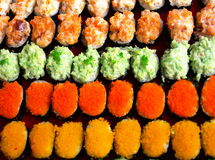 Sushi. Colorful rows of sushi delicacies Stock Image