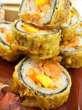 Sushi. Fried tempura makis filled with fish, rice and carrot royalty free stock photography