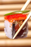 Sushi. With red caviar on the Chinese sticks Royalty Free Stock Photo