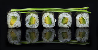 Sushi arranged on a shiny black surface looking delicious Stock Photo