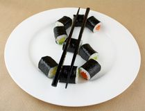 Free Sushi As Dollar Sign On White Plate Stock Image - 29943011