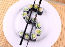Sushi as dollar sign on white plate Stock Images
