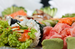 Sushi Assorted with Roll, Hand Roll, Sashimi, Ginger and Wasabi Royalty Free Stock Image