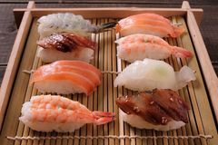 Sushi assorted wood box tray takeaway japanese food Stock Photos