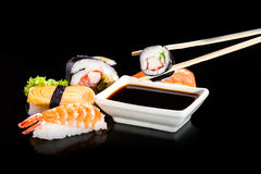 Sushi assortment on black background. Stock Photos
