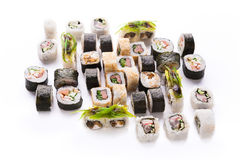 Sushi assortment isolated at white background. Traditional japanese restaurant food. Colorful vegetable and fish rolls closeup at white. Big party sushi set, pov stock photos