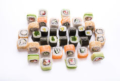 Sushi assortment isolated at white background. Traditional japanese restaurant food. Colorful vegetable and fish rolls closeup at white. Big party sushi set, pov stock photo