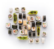 Sushi assortment on white background. Big set of seafood rolls covered with salmon, nori and seaweed. Japanese food delivery royalty free stock images