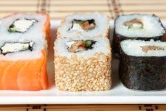 Sushi Assortment On White Dish over bamboo background. Stock Photo