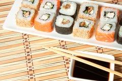 Sushi Assortment On White Dish over bamboo background. Stock Images