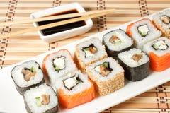 Sushi Assortment On White Dish over bamboo background. Royalty Free Stock Photography