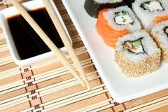 Sushi Assortment On White Dish over bamboo background. Stock Image
