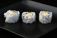 Sushi auf schwarzer Platte 1 Stockfoto