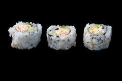 Sushi auf schwarzer Platte 1 Stockfotografie