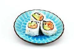 Sushi auf Teller Stockbilder
