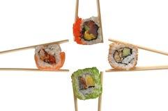 Sushi avec des baguettes Photographie stock libre de droits