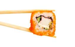 Sushi avec des baguettes photos libres de droits