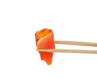 Sushi avec des poissons et des baguettes sur le blanc Images libres de droits