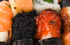 Sushi background. Sushi and rolls close-up Royalty Free Stock Photography