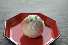 Sushi ball. Horse mackerel sushi ball with green onion on top Royalty Free Stock Images