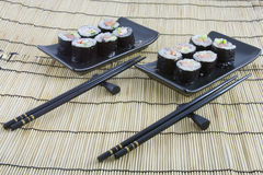Sushi on  bamboo mat Stock Images