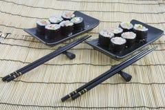 Sushi on  bamboo mat. Sushi on a bamboo mat Stock Images