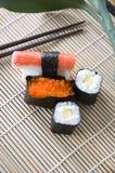 Sushi on bamboo mat Stock Photos
