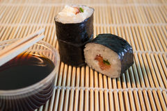 Sushi on bamboo mat Royalty Free Stock Images