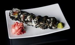 Sushi on black Stock Images