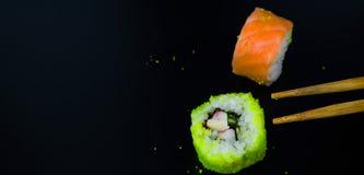 Sushi on a black background - food stock photo