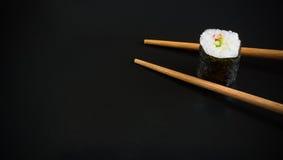 Sushi on black background Stock Photos