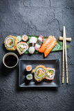 Sushi on the black ceramic dish Royalty Free Stock Photography