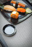 Sushi on black dish Stock Photo