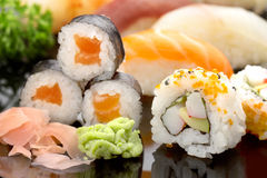 Sushi on black dish Royalty Free Stock Image