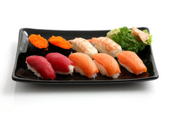 Sushi on black dish isolated in white background Royalty Free Stock Photo