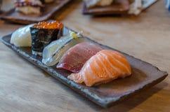 Sushi on the black dish Royalty Free Stock Photos
