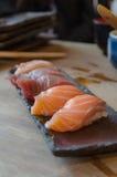 Sushi on the black dish Stock Photos