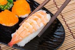 Sushi in black dish Stock Image
