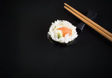 Sushi on black plate Stock Photo