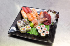 Sushi on black plate and metal background Stock Photo