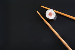 Sushi on black plate Stock Images