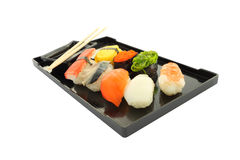 Sushi black rectangle plate focus near Royalty Free Stock Photography
