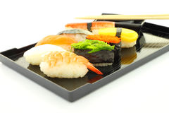 Sushi black rectangle plate focus shrimp Stock Photography