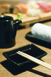 Sushi and black set of tableware Royalty Free Stock Photos