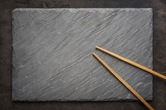 Sushi black slate and chopsticks Stock Photo