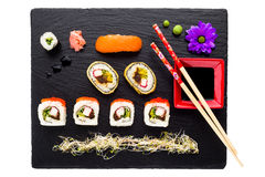Sushi on black stone plate isolated Royalty Free Stock Photo